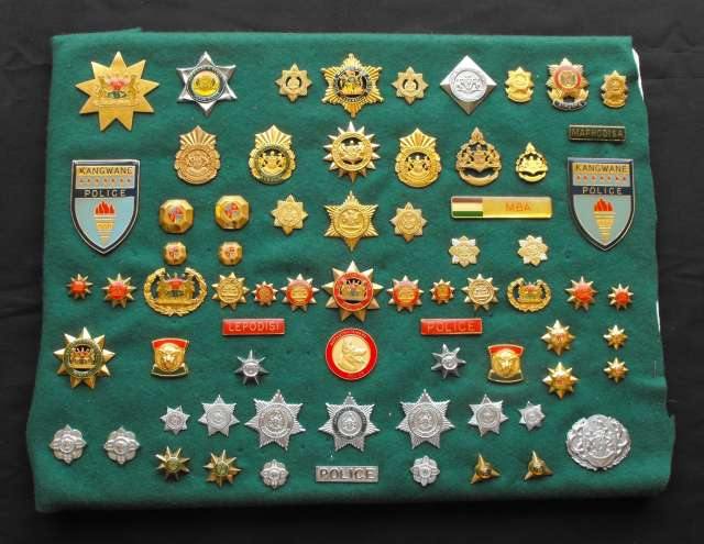 Collection of 70 South African Homelands Police and Defence Force Insignia Badges
